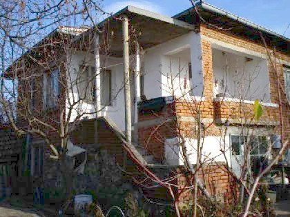 A solid-build brick house in decent condition